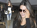 Getting the boot! Kendall Jenner slips her slender legs into baggy knee high suede boots to jet out of Los Angeles
