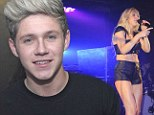 Niall Horan watches his scantily-clad ex Ellie Goulding belt it out during G-A-Y performance