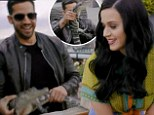 It's alive! Katy Perry screams in shock as magician David Blaine pulls an alligator out of her handbag... after eating a water glass