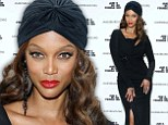Once a model, always a model! Tyra Banks vamps it up with a black cutaway dress and turban at a New York gala