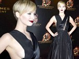 Jennifer Lawrence reveals major sideboob in vampy black dress and dark lipstick for Hunger Games: Catching Fire premiere in Paris