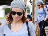 Keeping healthy for two! Olivia Wilde shows off her pregnant form as she finishes a light yoga workout
