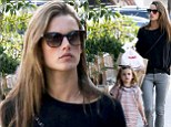 Days after glamming it up on the Victoria's Secret runway, Alessandra Ambrosio gets back to basics as she spends quality time with her mini-me daughter