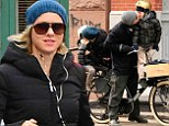 Stop, you're embarrassing me! Naomi Watts and Liev Shreiber smother their boys with kisses on family bike and run around the city