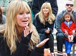 Heidi Klum's beau Martin Kristen bonds with her four-year-old daughter Lou as they cheer on Johan and Leni at soccer game