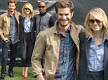 Emma Stone reunites with boyfriend Andrew Garfield and co-star Jamie Foxx for an Amazing Spiderman 2 fan event