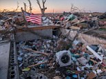 Deadly: Six people were killed and dozens of homes devastated when up to 80 tornadoes struck Illinois and the surrounding states