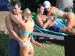 Best Sunday ever! Joanna Krupa put on a thong bikini and relaxed at the pool with her husband Romain Zago in Miami, Florida