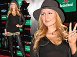 No amount of camouflage can hide that! Paris Hilton commits fashion faux pas in sheer top, leather trousers and army shorts