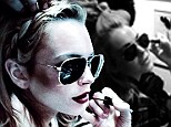 Shady behaviour! Lindsay Lohan gets glammed up for a shoot - but keeps her aviators on while getting her eyes made up