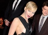Hot stuff: Jennifer Lawrence in her Dior dress at the premiere of Hunger Games: Catching Fire
