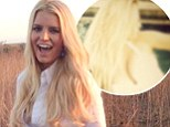 White hot! In a behind-the-scenes snap, Jessica Simpson showed off her incredible post-baby body in a plunging swimsuit from her JS collection