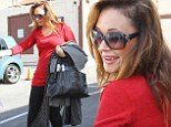 That¿s more like it! Red hot Leah Remini makes up for dowdy style blunder in a sexy tight outfit at DWTS rehearsal