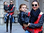 She doesn't need to be Photoshopped! Miranda Kerr looks picture perfect with Flynn after image-enhancing controversy