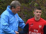 Next star? England boss Roy Hodgson speaks to Arsenal youngster Dan Crowley at a London Colney training session