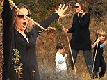 Probably not the best idea! Brooke Mueller enjoys pretend stick fight with twins... after Denise Richards accuses them of 'violent outbursts'