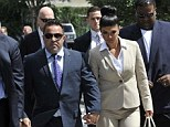More charges: On Monday Theresa and Joe Giudice were indicted on two more counts of fraud. The pair, seen here facing court in August, have already pled not guilty to 39 charges