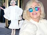 Trying to look innocent? Lady Gaga covers up in a virginal white ensemble after her raunchy Saturday Night Live performance