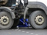 The mangled remains of the victim's bike trapped in the wheels of the lorry