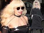 Back in black! Lady Gaga swaps angelic white for goth chic as she heads out in Canada