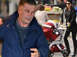 Under fire Alec Baldwin is grim-faced in New York while wife Hilaria dons high heeled boots for stroll with baby daughter