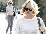 January Jones swaps her usual hipster style for much more mumsy garb as she heads out solo for lunch
