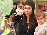 Fresh-faced Kourtney Kardashian dresses down in trackies as she takes children Mason and Penelope out for yoghurt