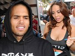 Anything for you! Chris Brown makes himself useful at a relief drive for the Philippines hosted by buxom former model Christine Mendoza