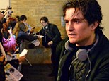 What's the hold up! Orlando Bloom pushes back barricade as fans almost knock it over during post show signing session