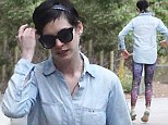Out of this world! Anne Hathaway grabs attention in galaxy print spandex leggings during walk with husband