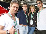 New besties? Gerard Butler schmoozed with Melanie Griffith and her husband Antonio Banderas before the start of United States Formula One Grand Prix at Circuit of The Americas in Austin, Texas on Sunday