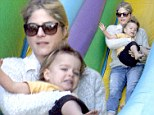Mommy, are you sure about this? Selma Blair loves the big yellow slide but her cute toddler Arthur looks uncertain