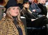 You're still distracting! Sexy Kate Upton covers up in floppy hat and turtleneck as she sits courtside at the Knicks game