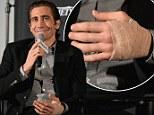 Grinning Jake Gyllenhaal displays bandaged hand at Prisoners screening following on-set injury