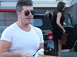Simon Cowell and Lauren Silverman arrive at CBS Studios in Hollywood