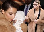 Kim Kardashian keeps baby North under wraps on family outing... but mommy's in the mood for showing off (of course) in plunging tuxedo jacket