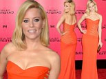 Flaming beauty! Elizabeth Banks turns up the heat in glitter-embellished orange gown at The Hunger Games: Catching Fire premiere