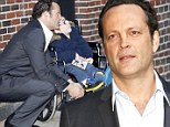 Showing his softer side: Vince Vaughn takes time out for a young fan in a wheelchair before an appearance on The Late Show