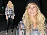 Ellie Goulding dresses down in plaid shirt and leather-effect trousers for Mini Cooper party in central London