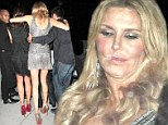 Worse-for-wear Brandi Glanville gets carried out of her 41st birthday party at Fleming's Wine Bar
