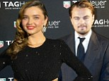 Dinner outing: Leonardo DiCaprio, shown earlier this month in Paris, and Miranda Kerr, shown earlier this month in Tokyo, dined together over the weekend in Las Vegas