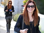 Not her usual look! Alyson Hannigan spices up her style in racy shorts and knee-high boots to run errands