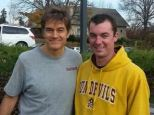 On the scene: Dr Mehmet Oz poses beside volunteer firefighter Chris Simpson, who both happened to be at the scene of a car crash in Philadelphia on Saturday. Dr Oz pulled a woman from a vehicle