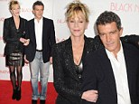 Third time's the charm! Melanie Griffith wears her favourite leather dress as she latches onto Antonio Banderas at film premiere