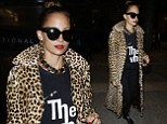Positively purr-fect! Nicole Richie touches down at LAX in full-length leopard-print coat