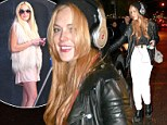 Goodbye socialite, hello scenester! Lindsay Lohan steps out in baggy trousers, leather jacket and huge headphones