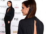 She could have done with a fitting herself! Victoria Beckham wears long gown with awkward gaping back for Global Gift Gala