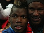 Paul Pogba of France celebrates with the fans after