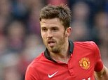 Herer to stay: Michael Carrick has signed a new deal at Manchester United until June 2015