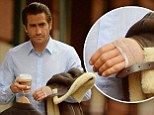 Now that's a rough cut! Injured Jake Gyllenhaal protects his stitched-up hand from the rain during a walk in Tribeca